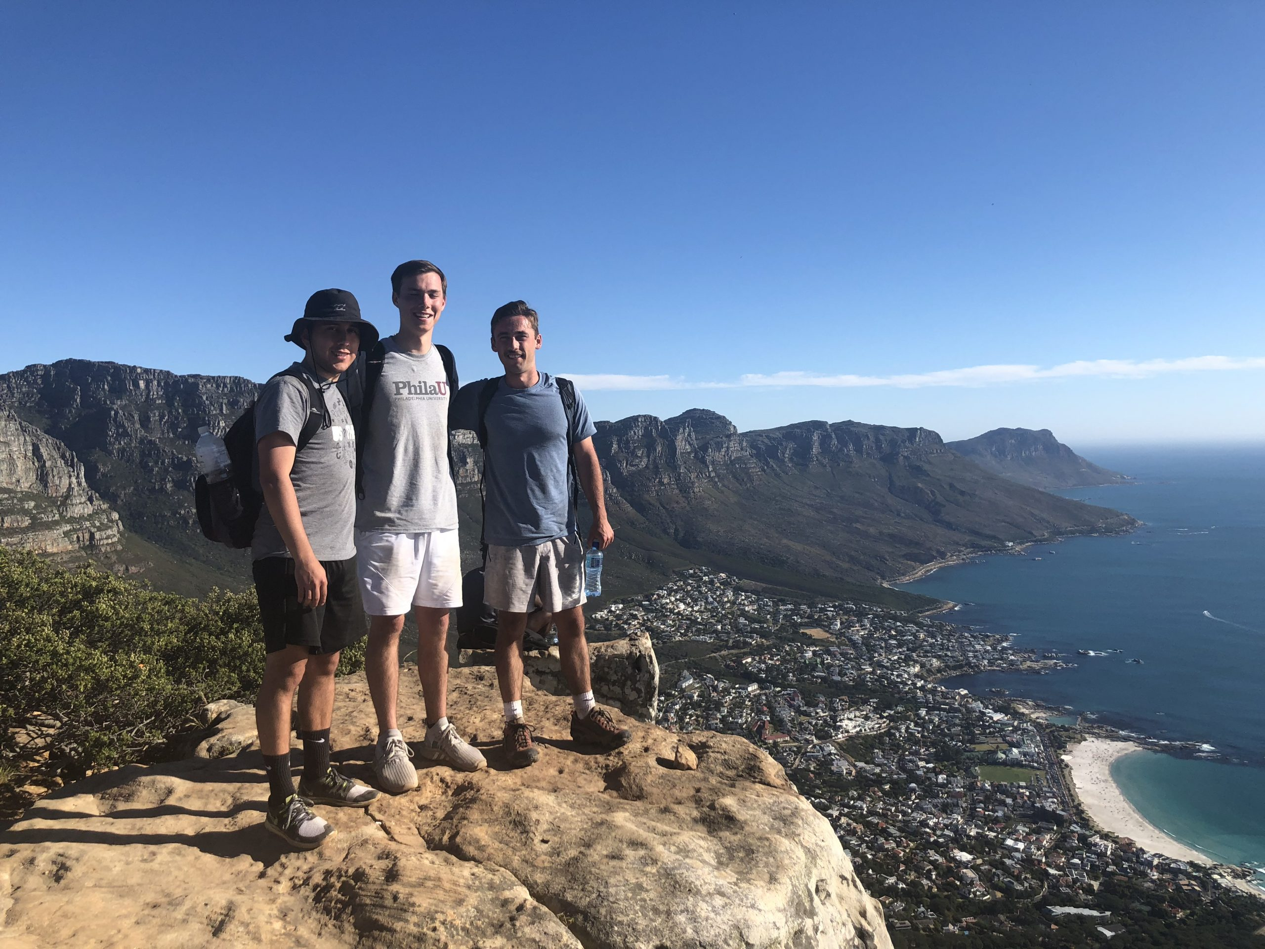 Photo of MLT Career Prep Alum Dennis Constanza with friends during his study abroad experience in South Africa