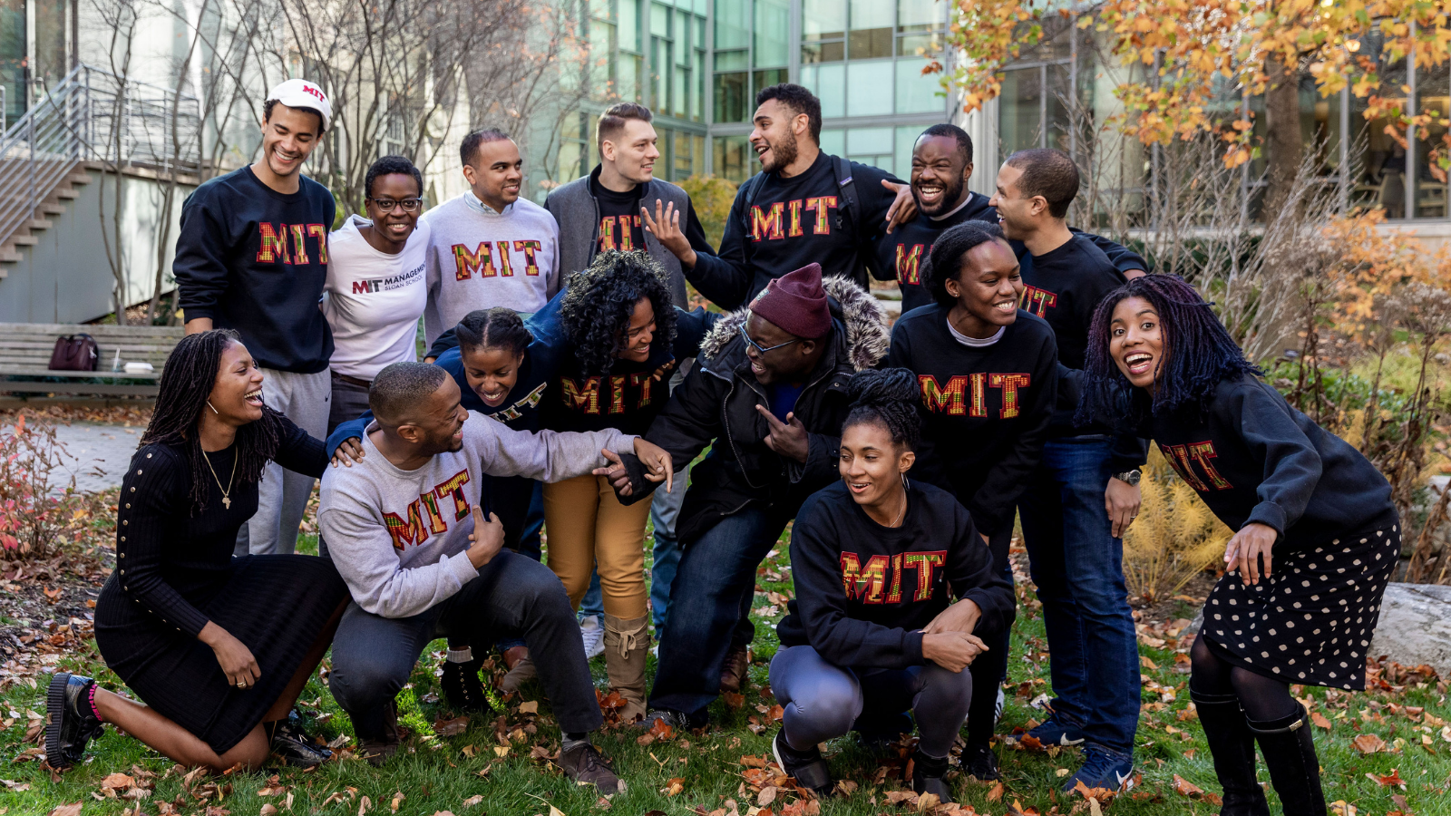 MBA Students from Black Business Students Association (BBSA) and Africa Business Club (ABC) wearing their Kente MIT sweatshirts